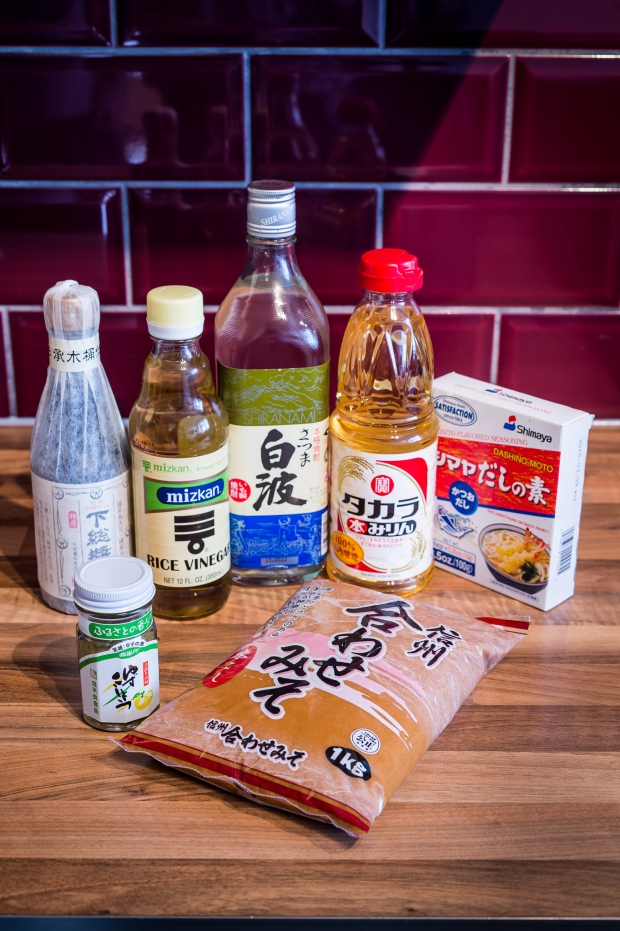 Clockwise from left: soy sauce, rice vinegar, shochu, mirin, dashi powder, miso, and yuzu-koshō. Photo by Paul Winch-Furness.